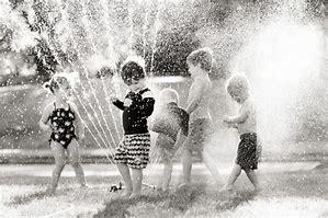 kids in sprinklers 1
